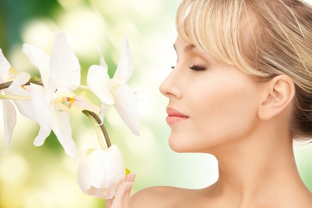 picture of beautiful woman with orchid flower Stock Photo - 17758685