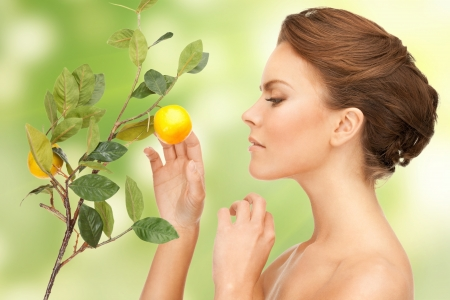 organic lemon: picture of lovely woman with lemon twig