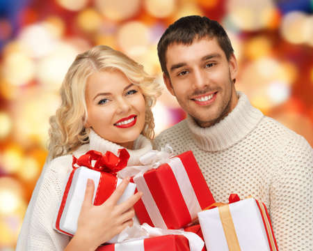 picture of family couple in a sweaters with gift boxes Stock Photo - 17758693