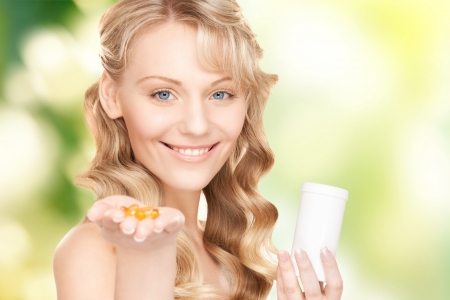 birth prevention: picture of young woman with pills Stock Photo