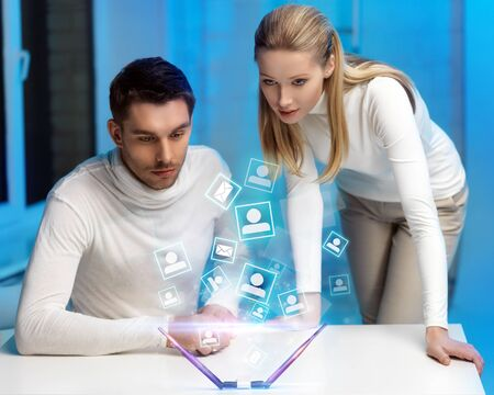 picture of man and woman working with virtual screen Stock Photo - 17758683