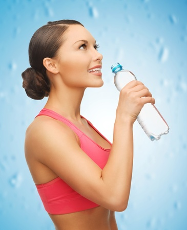 perfect fit: picture of sporty woman with bottle of water Stock Photo