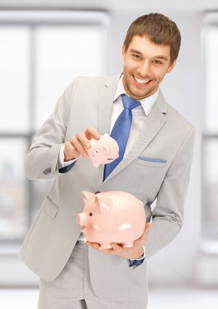 picture of handsome man with two piggy banks Stock Photo - 17758695