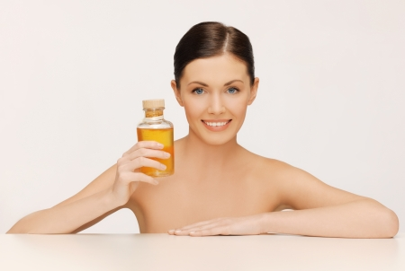 picture of beautiful woman with oil bottle photo