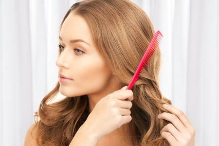 combing hair: bright picture of beautiful woman with comb