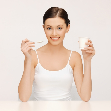 bright picture of beautiful woman with yogurt Stock Photo - 17758721