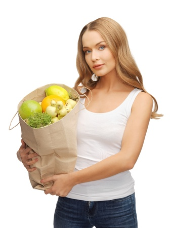 picture of woman with shopping bag full of fruits Stock Photo - 17758691