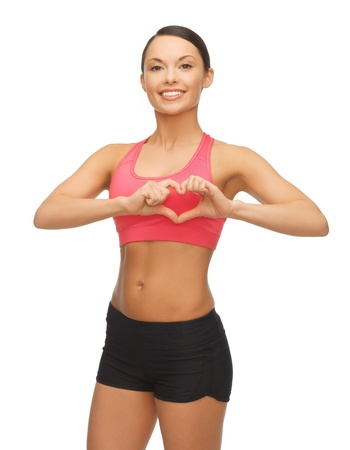 picture of beautiful sporty woman showing heart shape Stock Photo - 17758718