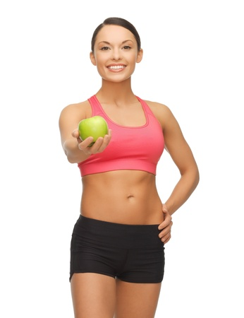 picture of beautiful sporty woman with apple Stock Photo - 17758714