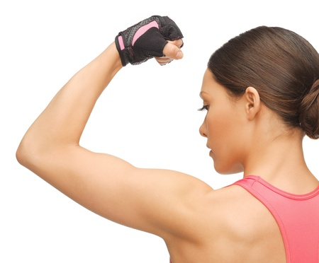 picture of beautiful sporty woman flexing her biceps photo