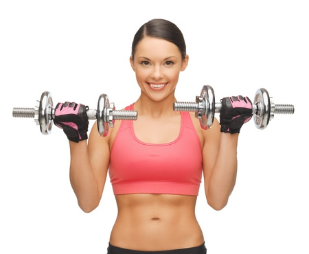 picture of beautiful sporty woman with dumbbells Stock Photo - 17758711