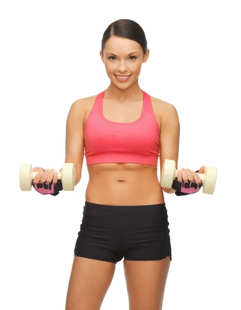 picture of beautiful sporty woman with dumbbells Stock Photo - 17758720