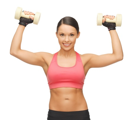 picture of beautiful sporty woman with dumbbells Stock Photo - 17758702