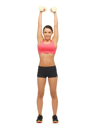 picture of beautiful sporty woman with dumbbells Stock Photo - 17758665