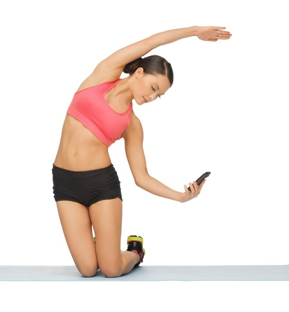 beautiful sporty woman with smartphone doing exercise Stock Photo - 17758675