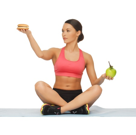 picture of sporty woman with apple and hamburger Stock Photo - 17758671
