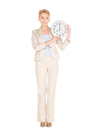 bright picture of woman holding big clock Stock Photo - 17758663