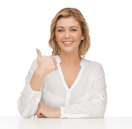 perfect sign: picture of woman in casual clothes showing thumbs up Stock Photo