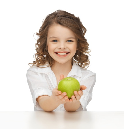 pre adolescent girl: picture of beautiful girl with green apple Stock Photo