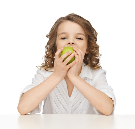 picture of beautiful girl with green apple photo