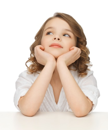 picture of thinking pre-teen girl in casual clothes photo
