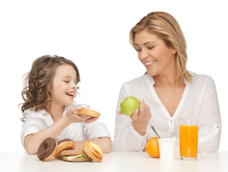 pre adult: mother and daughter with healthy and unhealthy food