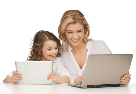 pre adult: mother and daughter with laptop and tablet pc Stock Photo