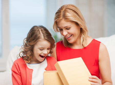 picture of mother and daughter with box Stock Photo - 17792076
