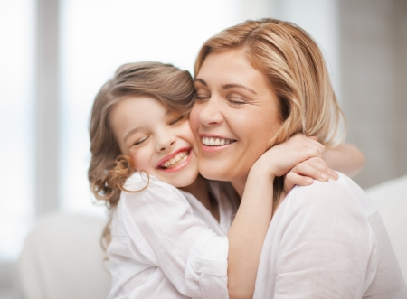 pre adult: bright picture of hugging mother and daughter Stock Photo