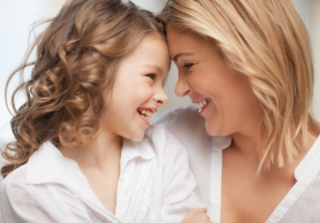 pre teens: bright picture of hugging mother and daughter Stock Photo