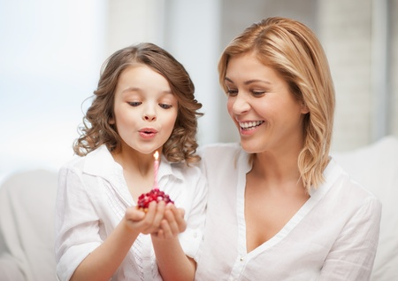 picture of mother and daughter with cupcake Stock Photo - 17792051