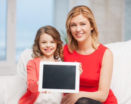 picture of mother and daughter with tablet pc photo