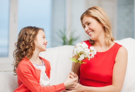 pre adult: picture of mother and daughter with flowers Stock Photo