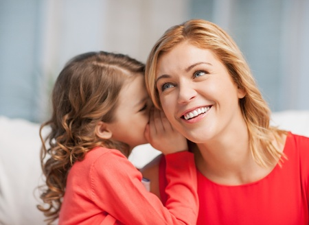 picture of mother and daughter whispering gossip photo