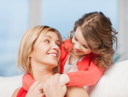 bright picture of hugging mother and daughter Stock Photo - 17791889