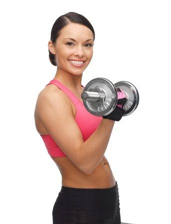 woman lifting weights: picture of beautiful sporty woman with dumbbells