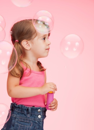 cool kids: bright picture of beautiful litle girl with soap bubbles