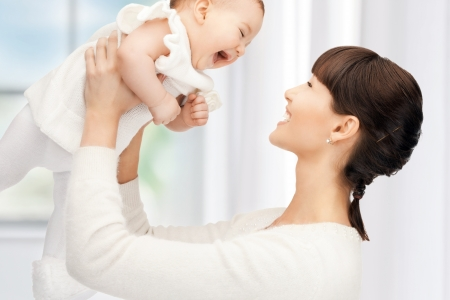 picture of happy mother with adorable baby  focus on woman  photo
