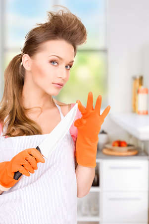 housewife gloves: picture of beautiful housewife with big knife