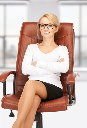 nerd girl: picture of young businesswoman sitting in chair