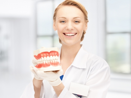 big teeth: picture of attractive female doctor with jaws