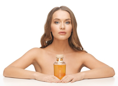 olive skin: picture of beautiful woman with oil bottle Stock Photo