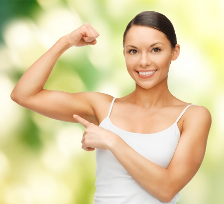 'personal beauty': picture of beautiful sporty woman flexing her biceps Stock Photo