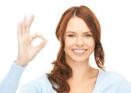 bright picture of young woman showing ok sign Stock Photo - 17862003