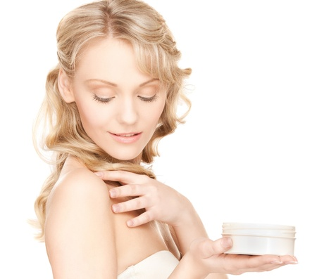 bath cream: picture of woman in bathrobe applying cream