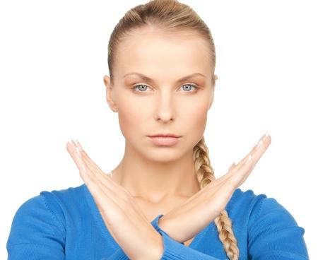 interdiction: image lumineuse de jeune femme faisant le geste d'arrêt Banque d'images