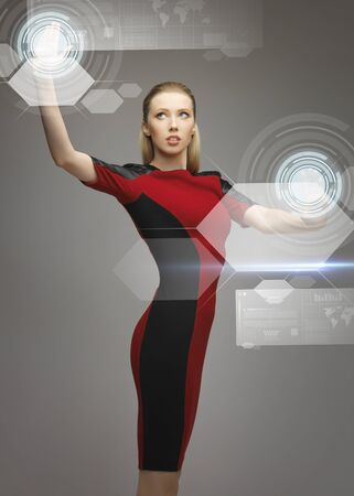 high tech world: picture of futuristic woman working with virtual touchscreens