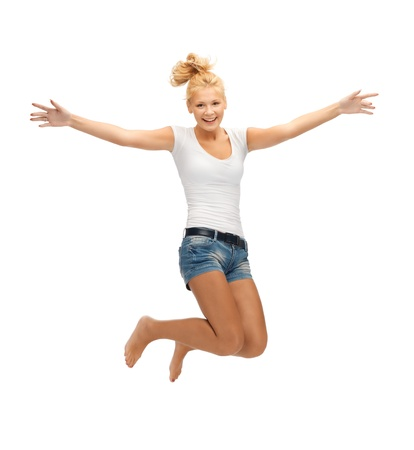 picture of jumping teenage girl in blank white t-shirt photo