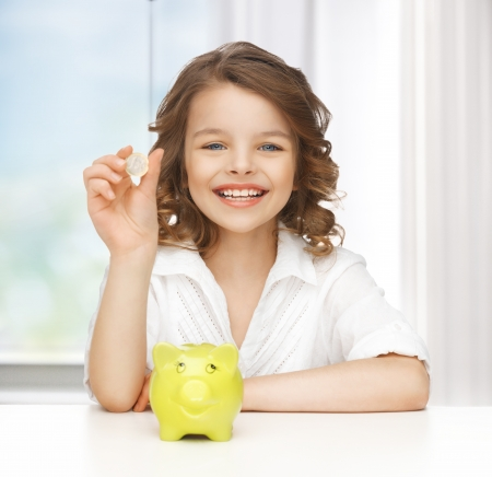 picture of beautiful girl with piggy bank Stock Photo - 18004922