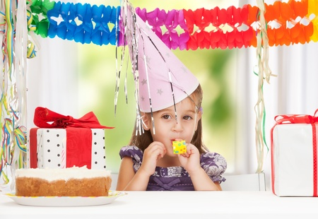 bright picture of beautiful litle girl with birthday cake photo